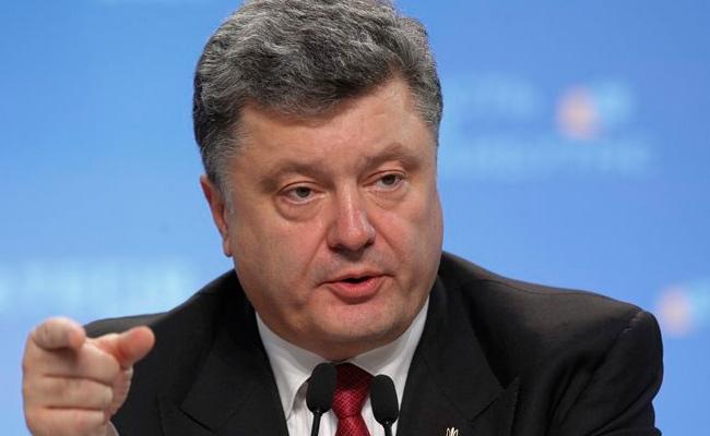 Президент подписал закон об отмене военного сбора с обмена валют